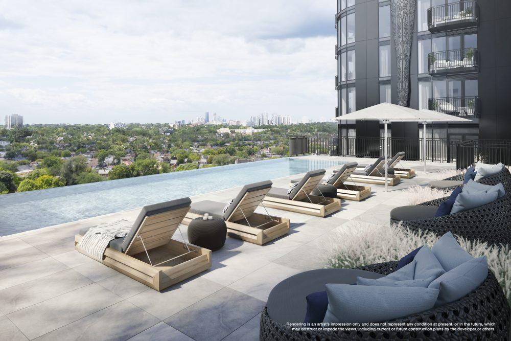 Rooftop lounge with comfortable seating beside the pool with view above treetops